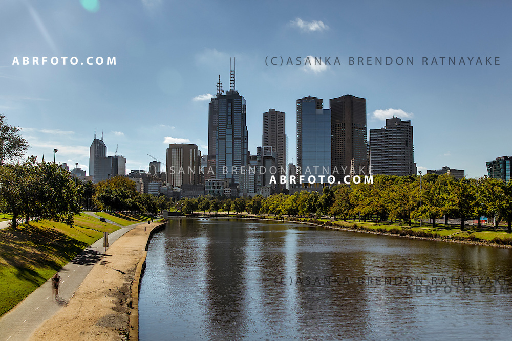 The Yarra River & Melbourne CBD city skyline in the background viewed from the Yarra Bridge