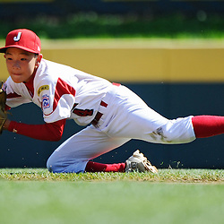 SOUTH WILLAMSPORT, PA - AUGUST 28:  Koutaro Kamikura #4 of Japan bobbles a ground ball during the game against Chinese Taipei on August 28, 2010 in South Willamsport, Pennsylvania. Japan won the International Championship 3-2.  (Photo by Drew Hallowell/Getty Images)