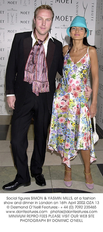 Social figures SIMON & YASMIN MILLS, at a fashion show and dinner in London on 16th April 2002.OZA 13
