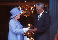 The Queen meets Nelson Mandela in South Africa in 1992...