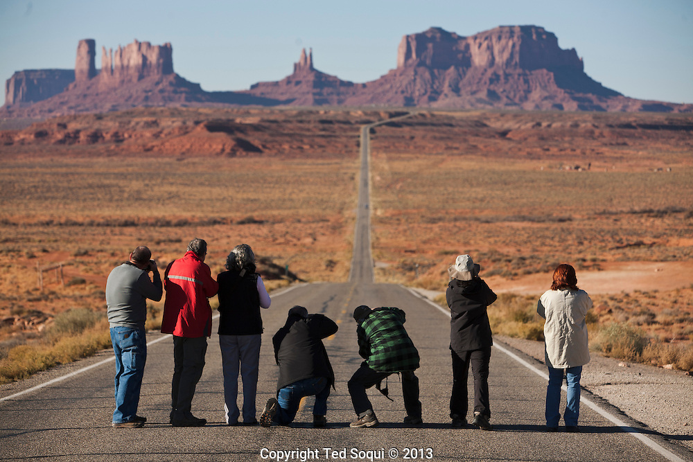 Photographers line up on a  long rode in to Monument Valley. <br /> This spot was also made famous in the film Forrest Gump.&quot;