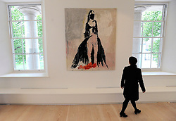 "© under license to London News Pictures. LONDON, UK  05/05/2011. A gallery worker walks in front of the tapestry 'The Black Cat' by Tracy Emin which took seven years to complete.  The unveiling today (5 May 2011) of Tracey Emin's first tapestry ahead of the launch of COLLECT, the Crafts Council's international craft fair for contemporary objects at the Saatchi Gallery, London. Tracy Emin say's: ""The Black Cat is one of my favourite paintings. It took me seven years to complete...""Photo credit should read Stephen Simpson/LNP."