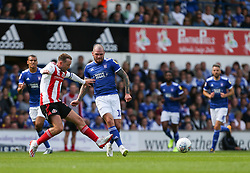 James Norwood of Ipswich Town passes the ball under pressure - Mandatory by-line: Arron Gent/JMP - 10/08/2019 - FOOTBALL - Portman Road - Ipswich, England - Ipswich Town v Sunderland - Sky Bet League One