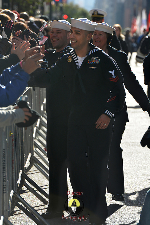 NEW YORK -- A Master-at Arms 2nd Class from Weapons Station Earle, NJ greets parade watchers of the 2017 New York City Veterans Day Parade. Sailors from local Navy units are participating in the parade to honor the service of all our nation's veterans. #USNavy, #NavyInNYC, #VeteransDay, #USNavy, #VeteransDay #NeverForget (U.S. Navy photo by Chief Mass Communication Specialist Roger S. Duncan/ Released)