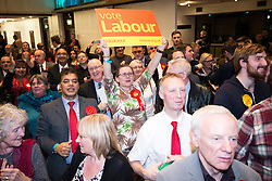© Licensed to London News Pictures . 04/12/2015 . Oldham , UK . Labour supporters cheer their victory at the count at the Oldham West and Royton by-election , at the Queen Elizabeth Hall in Oldham . The by-election was called following the death of MP Michael Meacher . Photo credit : Joel Goodman/LNP