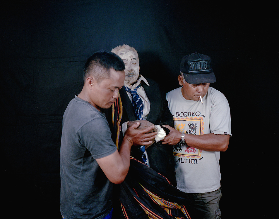 Markus Tombang who died in 2016 at age 64.<br /> <br /> Ma'nene is a tradition that takes place in August after harvest where the bodies of the dead loved ones are exhumed to be cleaned, groomed and dressed. For most, it's a bittersweet moment, a chance to reunite and physically see and touch and reconnect with loved ones who had passed on.