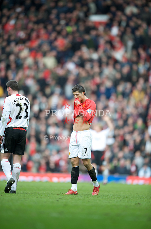 MANCHESTER, ENGLAND - Sunday, March 23, 2008: Manchester United's Christiano Ronaldo, shows off his chubby love handles, during the Premiership match against Liverpool at Old Trafford. (Photo by David Rawcliffe/Propaganda)
