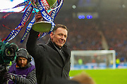 Celtic Legend Chris Sutton hold the Betfred Scottish League Cup aloft in front of the Celtic fans ahead of the Betfred Scottish League Cup Final match between Rangers and Celtic at Hampden Park, Glasgow, United Kingdom on 8 December 2019.
