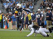 Dec 31, 2017; Carson, CA, USA; Los Angeles Chargers wide receiver Keenan Allen (13) leaps over Oakland Raiders strong safety Shalom Luani (26) during an NFL football game at StubHub Center. The Chargers defeated the Raiders 30-10.