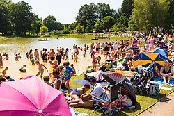 With temperatures soaring into the 30s hundreds take advantage of the hot weather and London's newest wild swimming lido at Beckenham Place in South East London. London, July 23 2019.