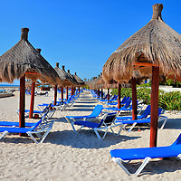 Empty Chaises Under Beach Umbrellas at Riviera Maya, Mexico<br />