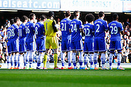 Chelsea players observe a minute's applause for Tom Finney before the Barclays Premier League match at Stamford Bridge, London<br /> Picture by David Horn/Focus Images Ltd +44 7545 970036<br /> 22/02/2014