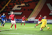 Ben Amos (goalkeeper) of Charlton Athletic blocks a shot by Aaron Holloway of Oldham Athletic during the EFL Sky Bet League 1 match between Charlton Athletic and Oldham Athletic at The Valley, London, England on 6 January 2018. Photo by Toyin Oshodi.