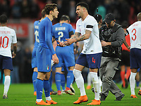 Football - 2018 International Friendly - England vs. Italy<br /> <br /> Federico Chiesa of Italy talks over the penalty incident with Kyle Walker  at the final whistle, at Wembley.<br /> <br /> COLORSPORT/ANDREW COWIE