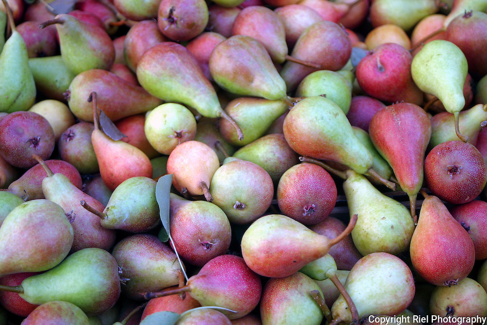 Freshly picked pears offered in a quiet Slovenian market.