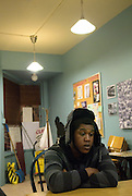 Windsor, Canada, 2014. Ucal, an adult student, is deep in thought near the end of a People's School class at Windsor Workers' Action Centre. The People's School is an experimental polular education initiative for the downtown Windsor community.