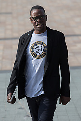 © Licensed to London News Pictures . 19/03/2015 . Salford Quays , UK . PAUL LEVERIDGE ( Kermit ) . Black Grape photocall at The Green , Salford Quays , Greater Manchester . Black Grape are reforming for a Madchester charity gig along with other local bands , to raise awareness for Bez's Reality Party and anti-fracking . Photo credit : Joel Goodman/LNP