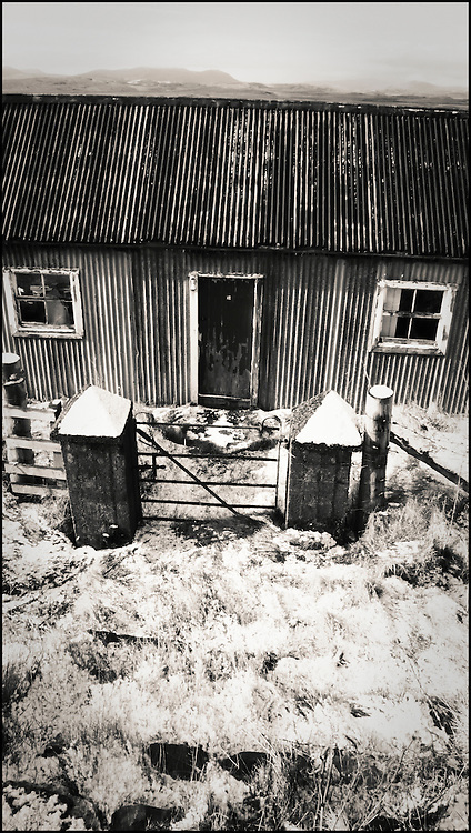 Corrugated Metal House On Isle Of Lewis, Scotland. Snow covering ground.