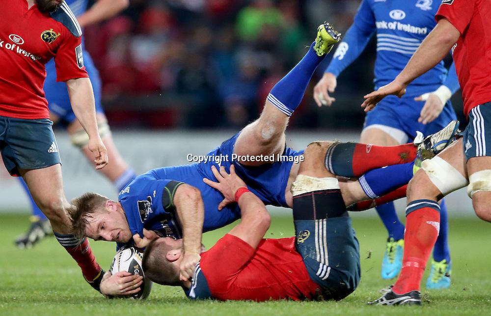 Guinness PRO12, Thomond Park, Limerick 26/12/2014<br /> Munster vs Leinster<br /> Munster's CJ Stander tackles Luke Fitzgerald of Leinster <br /> Mandatory Credit &copy;INPHO/Dan Sheridan
