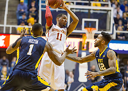 Feb 22, 2016; Morgantown, WV, USA; Iowa State Cyclones guard Monte Morris (11) is trapped by West Virginia Mountaineers forward Jonathan Holton (1) and guard Tarik Phillip (12) during the first half at the WVU Coliseum. Mandatory Credit: Ben Queen-USA TODAY Sports