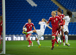 CARDIFF, WALES - Tuesday, August 21, 2014: England's Laura Bassett scores the third goal against Wales during the FIFA Women's World Cup Canada 2015 Qualifying Group 6 match at the Cardiff City Stadium. (Pic by Ian Cook/Propaganda)