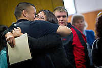 Charlotte Nilson receives a hug from a family member after leaving the courtroom.