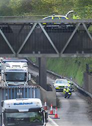 © Licensed to London News Pictures. 07/05/2019. Headley, UK. Police are seen on the M25 and also on a bridge above the carriageway after a body was found earlier. A lane was closed during the investigation causing tailbacks. Photo credit: Peter Macdiarmid/LNP