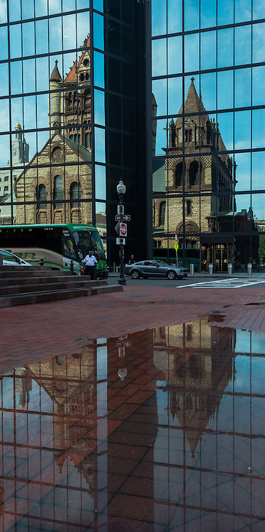 A reflection of Trinity Church.