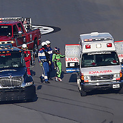 Danica Patrick, driver of the #7 GoDaddy Chevrolet is seen with emergency workers in turn four after crashing with Chase Elliott, driver of the (9) NAPA Autoparts Chevrolet, and Kasey Kahne, driver of the (95)Procore Chevrolet during the 60th Annual NASCAR Daytona 500 auto race at Daytona International Speedway on Sunday, February 18, 2018 in Daytona Beach, Florida. This would be Patrick's final NASCAR race.  (Alex Menendez via AP)