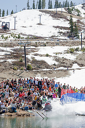 """""""Cushing Classic at Squaw Valley 4"""" - Photograph of a skier crossing a pond during the Cushing Classic at Squaw Valley, USA."""