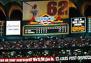 "ST. LOUIS, MO-SEPTEMBER 8:   The scoreboard reflects the fact that Mark McGwire #25 of the St. Louis Cardinals made baseball history by hitting his 62nd home run of the season, breaking the single season home run record held by Roger Maris in 1961, on September 8, 1998 at Busch Stadium in St. Louis, Missouri.  The summer of 1998 what has been called the ""Great Home Run Race of 1998"".  McGwire and Sammy Sosa were both attempting to break the single season home run record of 61 held by Roger Maris since 1961.(Photo by Ron Vesely)"