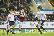 Derby County defender Stephen Warnock and Burnley forward Sam Vokes  challenge for the ball during the Sky Bet Championship match between Burnley and Derby County at Turf Moor, Burnley, England on 25 January 2016. Photo by Simon Davies.