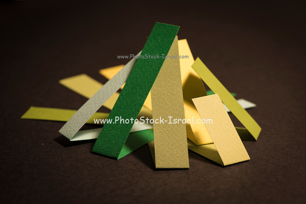 Colourful strips of cardboard as texture and background on black background