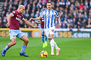 Chris Lowe of Huddersfield Town (15) takes on Pablo Zabaleta of West Ham United (5) moments before being injured during the Premier League match between Huddersfield Town and West Ham United at the John Smiths Stadium, Huddersfield, England on 10 November 2018.