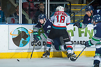 KELOWNA, CANADA - APRIL 25: Tyler Adams #17 of the Seattle Thunderbirds is checked by Carsen Twarynski #18 of the Kelowna Rockets on April 25, 2017 at Prospera Place in Kelowna, British Columbia, Canada.  (Photo by Marissa Baecker/Shoot the Breeze)  *** Local Caption ***