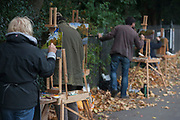 Members of the Dulwich Art Group paint an urban Autumn landscape on Denmark Hill, on 2nd October 2017, in the south London borough of Lambeth, England.
