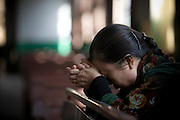 A Chinese woman prays during a church service in Pucheng, Shanxi.