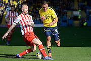 Stevenage defender Keith Keane tackles Oxford midfielder Kemar Roofe during the Sky Bet League 2 match between Oxford United and Stevenage at the Kassam Stadium, Oxford, England on 25 March 2016. Photo by Alan Franklin.