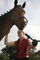 Girl grooming horse