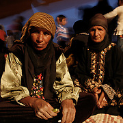 Interior of a Bedouin tent. The Bedouin women usually wear brightly coloured long dresses but when they go outside they dress in an 'abaya' o Mandraga (a long black coat sometimes covered with shiny embroidery) and they will always cover their head and hair when they leave their house with a 'tarha',a black shaw.