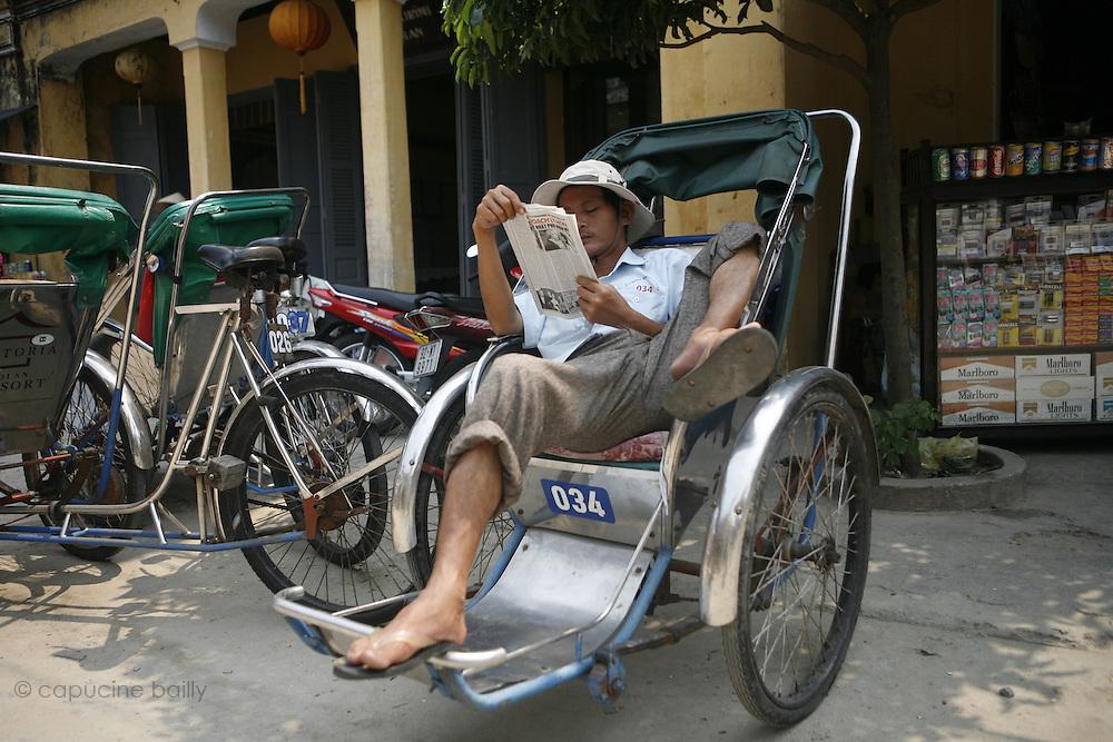 Hoi An, Vietnam. March 14th 2007..A cyclo-pousse driver takes a break.
