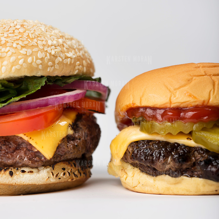 "June 11, 2014 - New York, NY : New York Times writer and editor Sam Sifton describes the difference between ""pub"" and ""diner""-style hamburgers. The ""pub"" burger, which is pictured here at left, is larger, shaped like a fat hockey puck, and takes longer to cook. In contrast, the ""diner"" burger, at right, is smaller, shaped like a frisbee, and cooks substantially quicker. CREDIT: Karsten Moran for The New York Times"