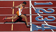 05/14/2009 - Benson's Kayla Smith (410) cruises to an easy win in the women's 100 meter dash. The 6A PIL Varsity District Track Meet takes place at Lewis and Clark College....KEYWORDS:  City, Portland, sports, high school, state, boys, girls