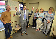 Executive Director of Bucks County Democrats Eric Nagy (center) gestures as he speaks to supporters of Hillary Clinton and former California Congressman Tony Coelho (left) listens at the opening of the Hillary Clinton campaign office Thursday April 21, 2016 in Doylestown, Pennsylvania. (Photo by William Thomas Cain)