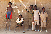 Boy stand next to a building marked for demolition in the village of Popoko, Bas-Sassandra region, Cote d'Ivoire on Tuesday March 6, 2012.