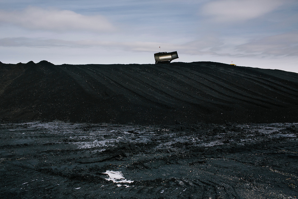 Bulldozers shape mounds of coal based on the type to ensure no floughing occurs and to improve it's aerodynamics so no coal blows off the top at Consol Energy's Baltimore Terminal on March 6, 2014. The facility is one of the main areas for foriegn-bound coal.