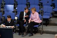 13 FEB 2009, BERLIN/GERMANY:<br /> Guido Westerwelle (L), FDP Bundesvorsitzender, und Angela Merkel (R), CDU, Bundeskanzlerin, im Gespraech, waehrend der Bundestagsdebatte zum zweiten Konjunkturpaket zur Sicherung von Beschaeftigung und Stabilitaet in Deutschland, Plenum, Deutscher Bundestag<br /> IMAGE: 20090213-01-065<br /> KEYWORDS: Gespräch