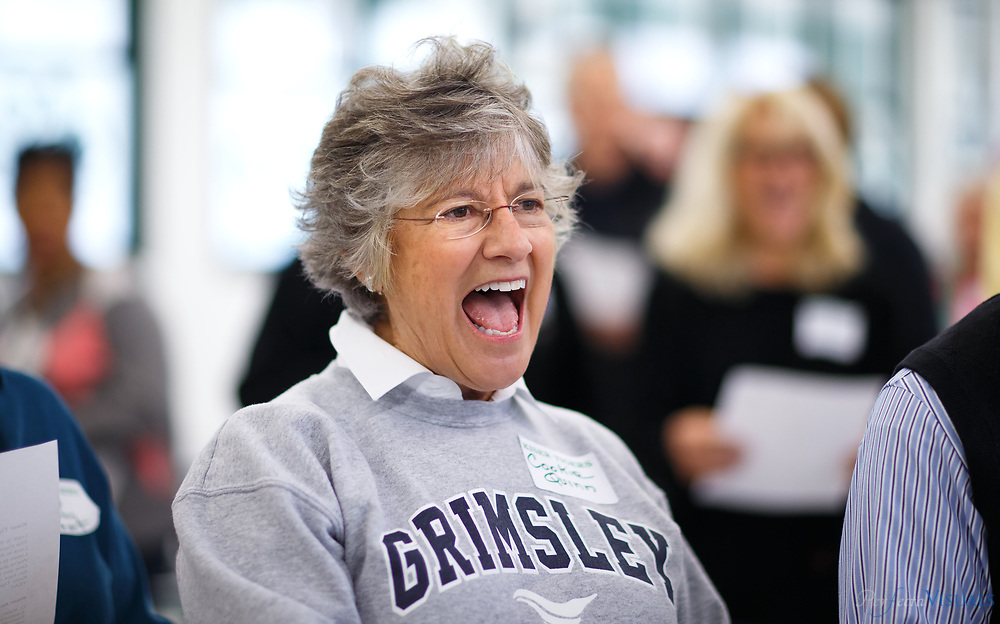 Cookie Quinn laughs as the alumni prepare to sing the fight song.<br /> <br /> <br /> At least 50 alumni and two former teachers came together Saturday to celebrate the 60th anniversary of Kiser Middle School. The Kiser Alumni Association put together the celebrate to honor the school's recent accomplishments, its illustrious past and its newest milestone. Named after former mayor and school board chairman, Claude Kiser, the school turned 60 this year.<br /> <br /> Photographed, Saturday, October 28, 2017, in Greensboro, N.C. JERRY WOLFORD  / Perfecta Visuals