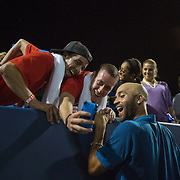 August 21, 2014, New Haven, CT:<br /> James Blake poses for a selfie photograph with fans during the Men's Legends Event on day seven of the 2014 Connecticut Open at the Yale University Tennis Center in New Haven, Connecticut Thursday, August 21, 2014.<br /> (Photo by Billie Weiss/Connecticut Open)