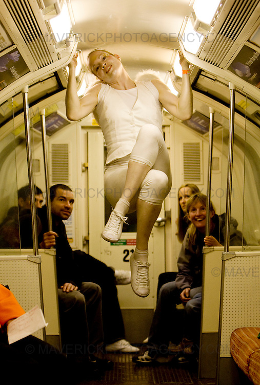 An Acrobat performs on the Glasgow underground as part of the Glasgow Subway Festival...Picture Michael Hughes/Maverick ...